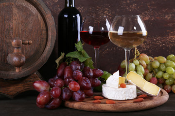 Supper consisting of Camembert cheese, wine and grapes