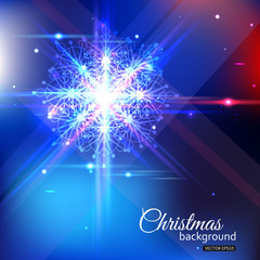 Shining christmas background with crystal snowflake and blurred