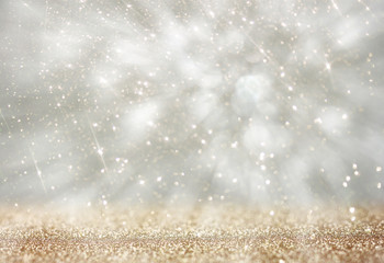 bokeh lights background with colors of white and silver and moti