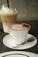 cup of hot chocolate with ice coffee