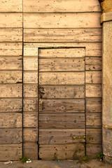 sumirago  brass brown knocker in a  door curch  closed wood ital