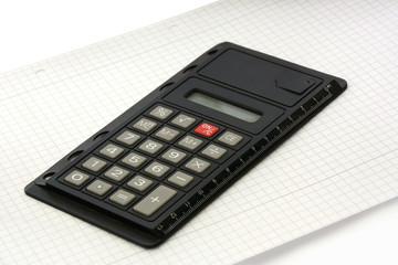 Taschenrechner mit Papier