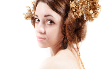 young woman in rural style with flax and dried flowers
