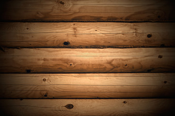 Wall made ​​of wooden logs closeup.