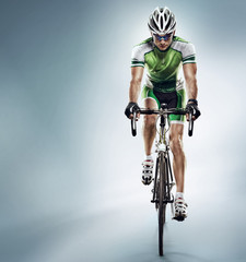 Isolated athletic cyclist. Sport