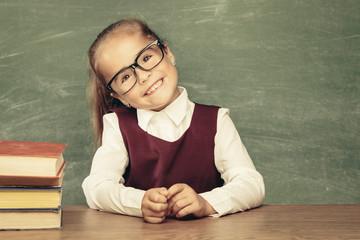 Girl (child) against chalkboard