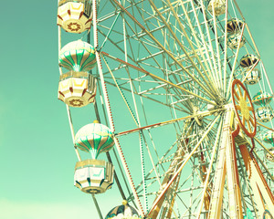 Summer ferris wheel over mint sky