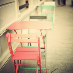 Vintage tables and chairs in a sidewalk cafe