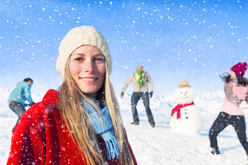 Group Of Friends With A Snowman