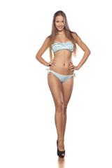 pretty young girl posing in a bikini
