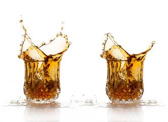 Two Whiskey Splash Isolated on White Background