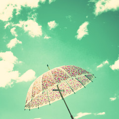 Vintage umbrella and sky with clouds
