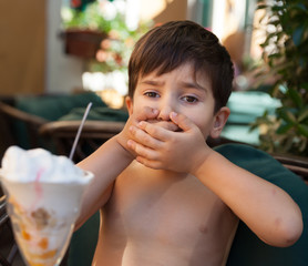 boy does not want to eat ice cream