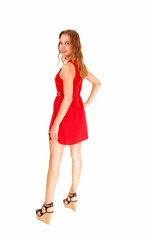 Woman in red dress Standing.