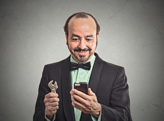 businessman looking at smartphone holding business tool