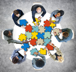 Group of People with Jigsaw Puzzle in Photo and Illustration