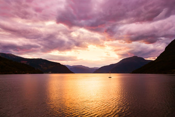 Sunset in fjord Hardanger Norway