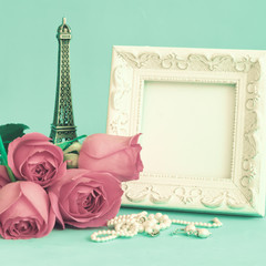Vintage photo frame and red roses