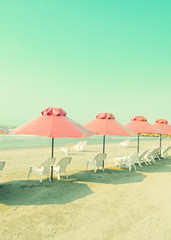 Vitnage pink umbrellas in the beach