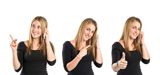 Girl talking to mobile over isolated background.