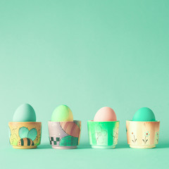 Hand-painted easter eggs in ceramic cups