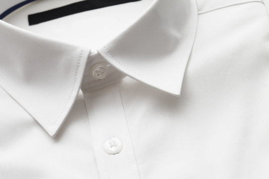 Close up of white collar on shirt, studio