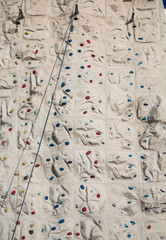 Blue Rope Angled Across Climbing Wall