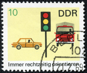 stamp printed in GDR shows car, truck and light signal
