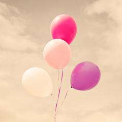 Vintage helium balloons in flight