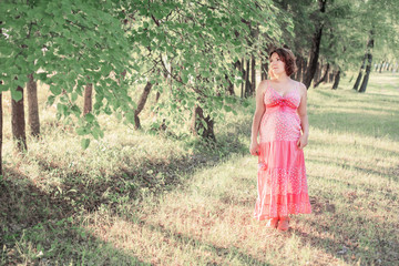 Beautiful pregnant woman outdoor