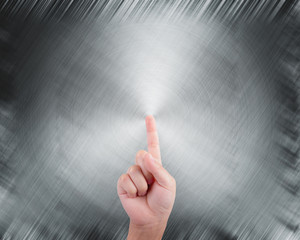 hand pointing on abstract grey metal background
