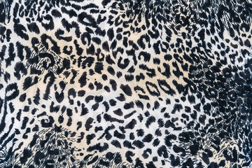 close up texture of print fabric striped leopard