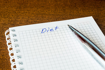 Diet sign in the notebook by pen