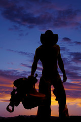 silhouette cowboy no shirt hold saddle look down