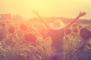 Happy woman in sunflower fields