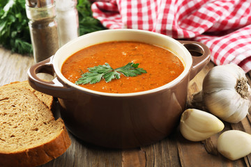 Delicious lentil cream-soup on table close-up