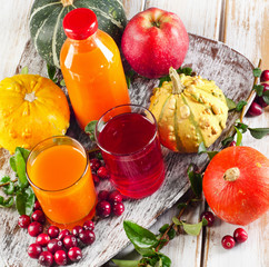 Healthy fresh Juices, fruits  and pumpkins - autumn still life.