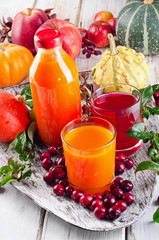 fresh Juices, fruits  and pumpkins - autumn still life.