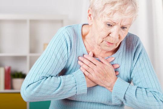 Elderly woman having heart attack