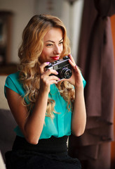 Woman photographer taking pictures with retro film camera