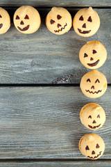 Tasty Halloween macaroons on wooden table