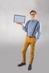 Geeky businessman showing his laptop