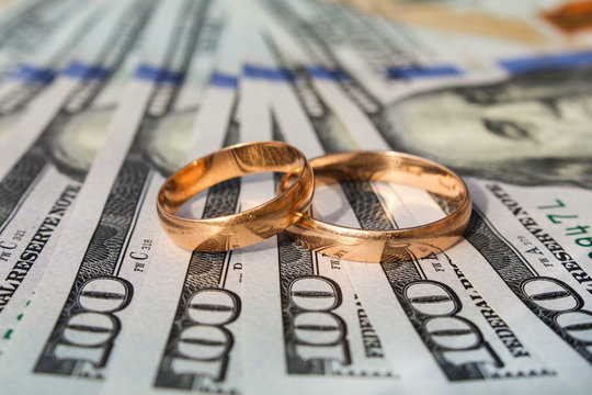 Wedding rings on the background of money