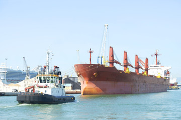 Ship and tugboat