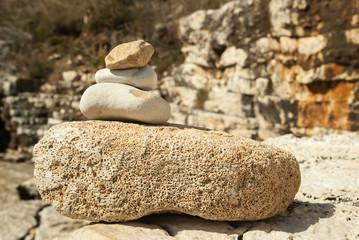 Sea pebble pyramid tower on seacoast. Stone Tower