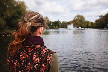 Woman looking at lake in a park