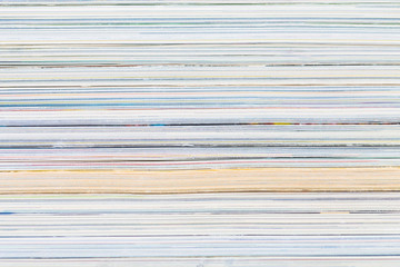 close-ups of stack of colorful magazines
