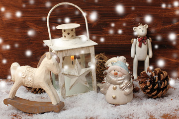 rocking horse,teddy bear and lantern on christmas background
