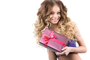 Portrait of beautiful smiling girl with gifts