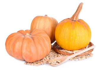 Pumpkins and seeds isolated on white